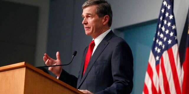 North Carolina Gov. Roy Cooper speaking in Raleigh on Tuesday. (Ethan Hyman/The News & Observer via AP)